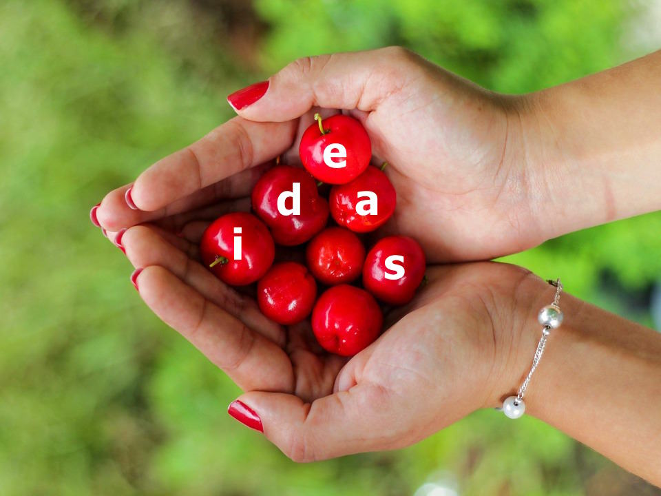 hands holding cherry, holding onto ideas, stopping creativity